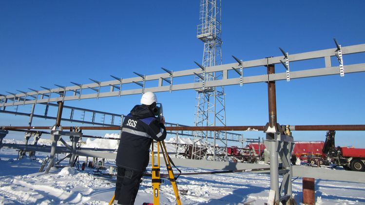 SGS personnel on snowy construction site with iron steel